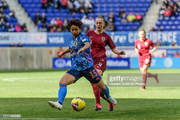 Mina Tanaka of Japan is marked by Keira Walsh of England during a game between England and Japan at Red Bull Arena on March 08, 2020 in Harrison, New...