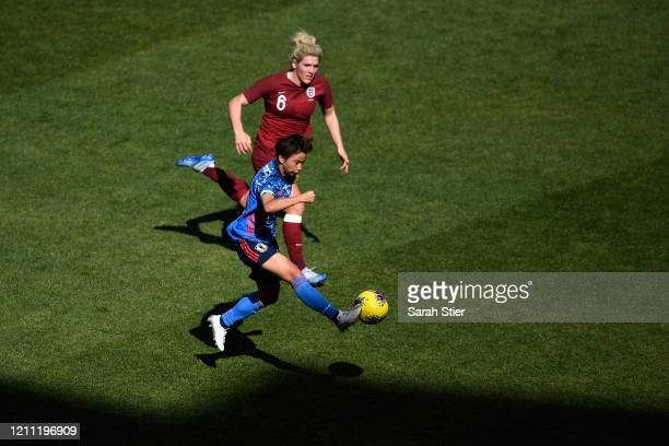 Mina Tanaka of Japan passes the ball as Millie Bright of England defends during the first half in the SheBelieves Cup at Red Bull Arena on March 08,...