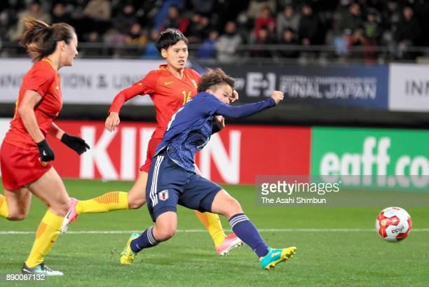 Mina Tanaka of Japan scores the opening goal during the EAFF E1 Women's Football Championship between Japan and China at Fukuda Denshi Arena on...