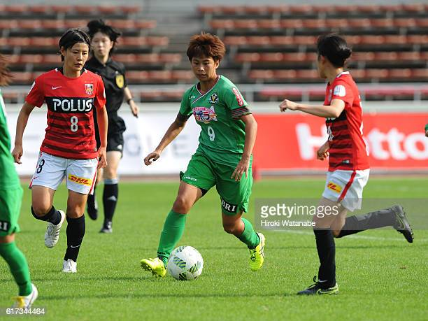 Mina Tanaka of NTV Beleza and Hikaru Naomoto of Urawa Red Diamonds compete for the ball during the Nadeshiko League match between Urawa Red Diamonds...