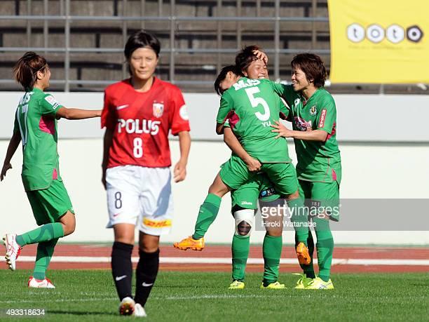 Mina Tanaka of NTV Beleza celebrates scoring her team's first goal with her team mates during the Nadeshiko League match between Urawa Red Diamonds...
