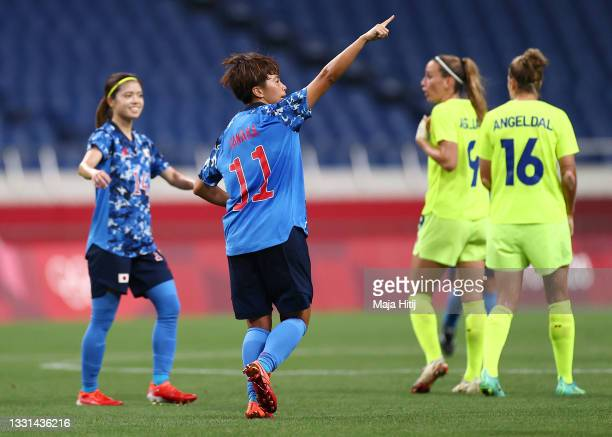 Mina Tanaka of Team Japan celebrates after scoring their side's first goal during the Women's Quarter Final match between Sweden and Japan on day...
