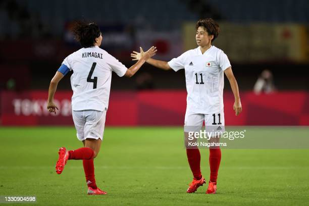 Mina Tanaka of Team Japan celebrates with Saki Kumagai after scoring their side's first goal during the Women's Group E match between Chile and Japan...