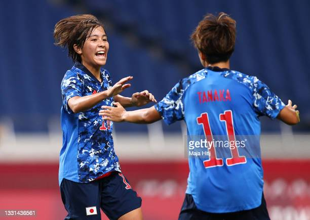 Mina Tanaka of Team Japan celebrates with teammate Mana Iwabuchi after scoring their side's first goal during the Women's Quarter Final match between...