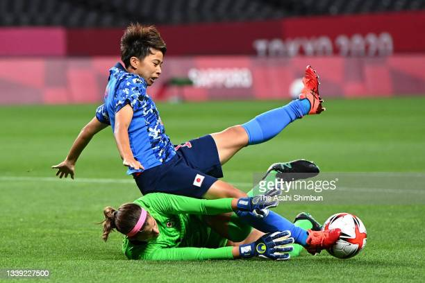 Mina Tanaka of Team Japan is brought down by Stephanie Labbe of Team Canada resulting in a penalty during the Women's First Round Group E match...