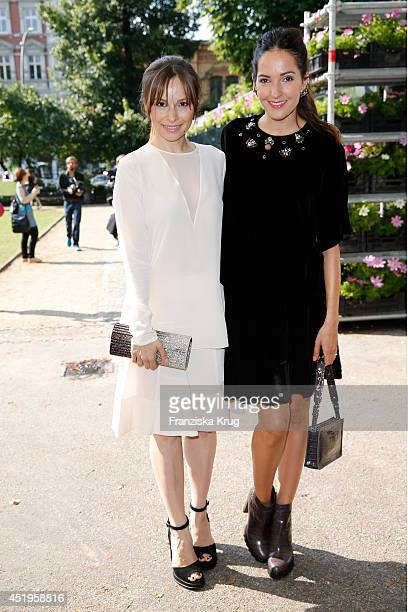 Mina Tander and Johanna Klum attend the Schumacher show during the MercedesBenz Fashion Week Spring/Summer 2015 at Sankt Elisabeth Kirche on July 10...