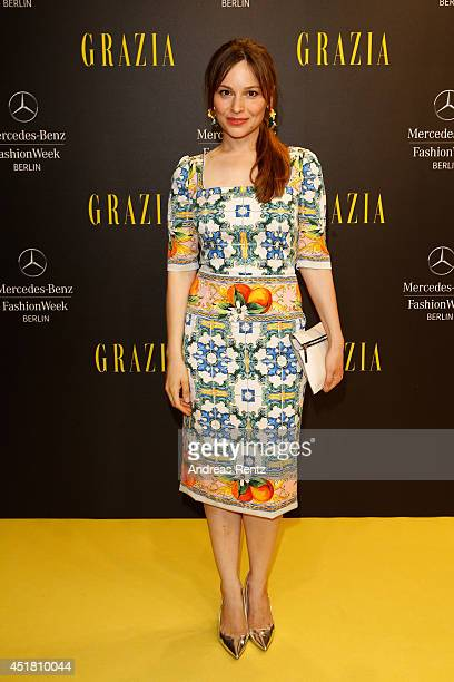 Mina Tander arrives for the Opening Night by Grazia fashion show during the MercedesBenz Fashion Week Spring/Summer 2015 at Erika Hess Eisstadion on...