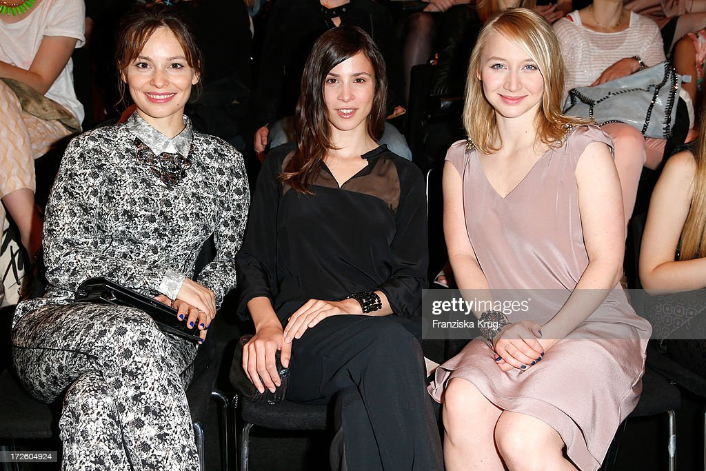Mina Tander, Aylin Tezel and Anna Maria Muehe attend the Schumacher Show during Mercedes-Benz Fashion Week Spring/Summer 2014 at the Brandenburg Gate on July 4, 2013 in Berlin, Germany.