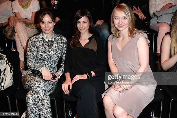 Mina Tander Aylin Tezel and Anna Maria Muehe attend the Schumacher Show during MercedesBenz Fashion Week Spring/Summer 2014 at the Brandenburg Gate...