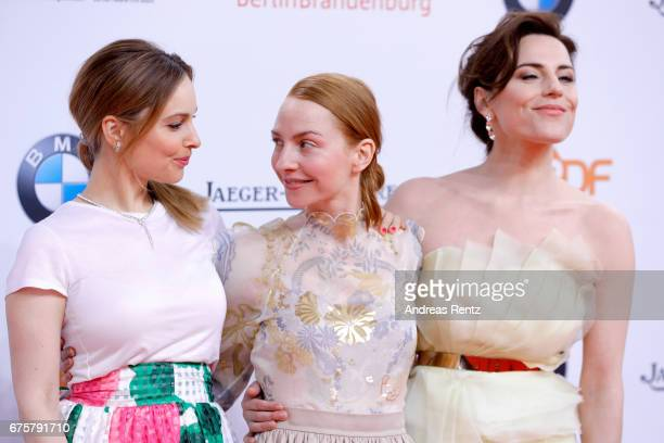 Mina Tander, Katharina Schuettler and Antje Traue attend the Lola - German Film Award red carpet at Messe Berlin on April 28, 2017 in Berlin, Germany.