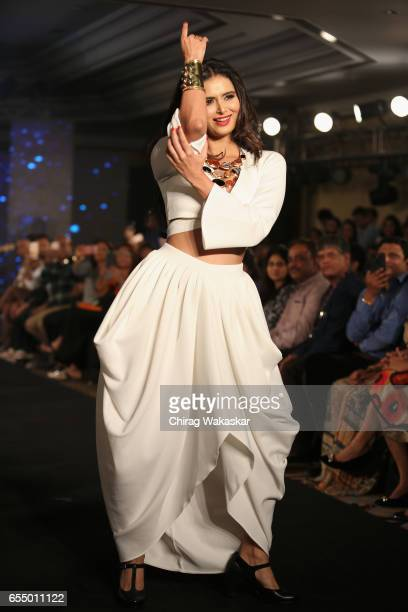 Minakshi Dixit walks the runway at the Mona Shroff show during India Intimate Fashion Week 2017 at Hotel Leela on March 18 2017 in Mumbai India