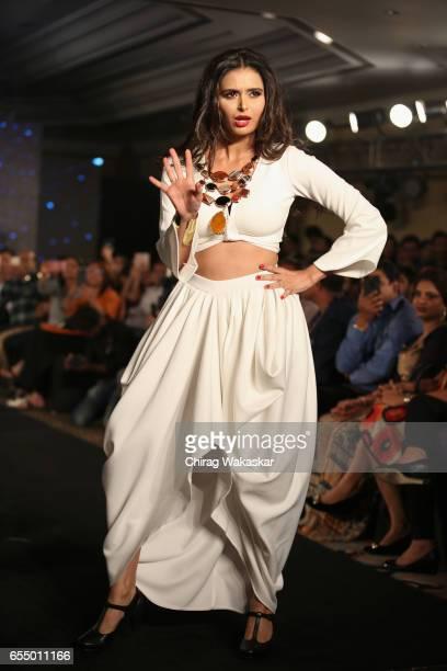 Minakshi Dixit walks the runway at the Mona Shroff show during India Intimate Fashion Week 2017 at Hotel Leela on March 18 2017 in Mumbai India