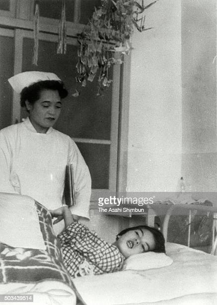Minamata disease patient lies on the bed in the Minamata City Hospital on April 1 1960 in Minamata Kumamoto Japan