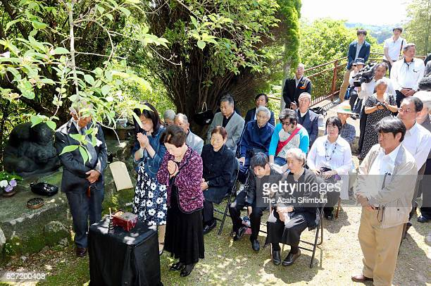 Minamata disease patients and family members attend a memorial ceremony on May 1 2016 in Minamata Kumamoto Japan On May 1 the head of the hospital in...