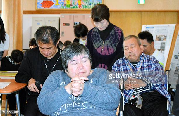 Minamata disease patients and family members observe a minute of silence at a support facility for the patients on May 1 2016 in Minamata Kumamoto...