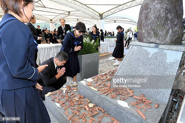 Minamata Disease patients and family members pray in front of the memorial during the ceremony to mark 60th anniversary of the disease's official...