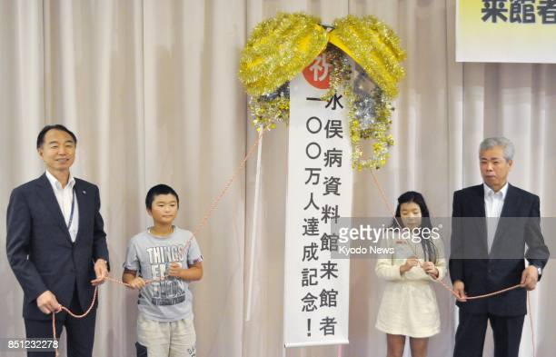 Minamata Mayor Hiroshi Nishida and Masami Ogata chairman of a group of Minamata mercurypoisoning disease patients and their families attend a...