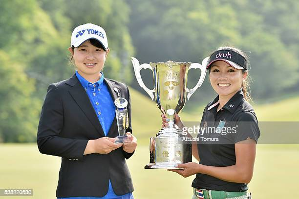 Minami Hiruta of Japan and P Chutichai of Thailand pose with the trophy after the final round of the Yonex Ladies Golf Tournament 2016 at the Yonex...