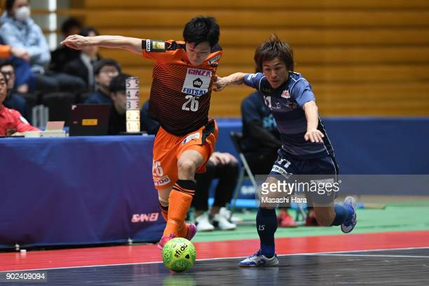 Minami Kato of Shriker Osaka and Yusuke Nakamura of Agleymina Hamamatsu compete for the ball during the FLeague match between Shriker Osaka and...