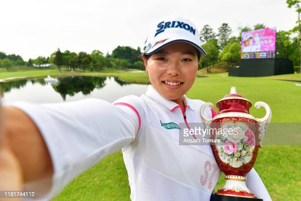 Minami Katsu of Japan celebrates with the trophy after the award ceremony following the final round of the Chukyo TV Bridgestone Ladies Open at...