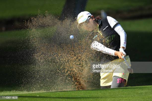 Minami Katsu of Japan hits from a sand trap to the 12th green during the second round of the LOTTE Championship on April 19 2019 in Kapolei Hawaii