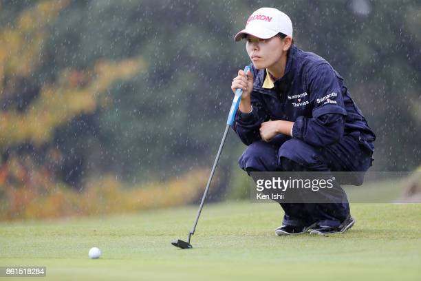 Minami Katsu of Japan lines up for a putt on the 9th hole during the final round of the Udonken Ladies at the Mannou Hills Country Club on October 15...
