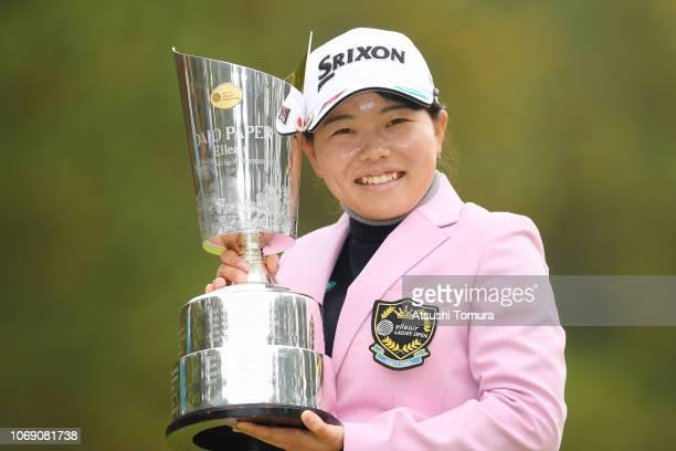 Minami Katsu of Japan poses with the trophy after winning the Daio Paper Elleair Ladies Open at Elleair Golf Club Matsuyama on November 18 2018 in...