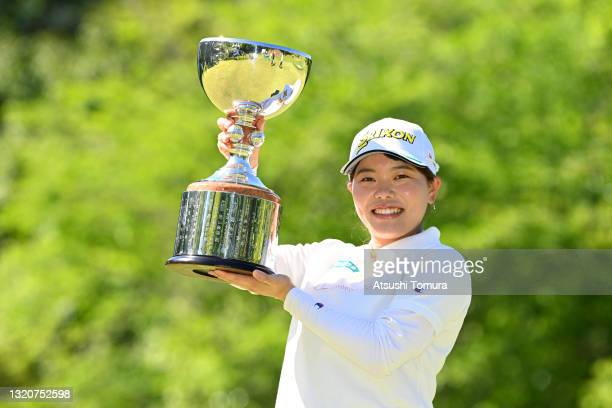 Minami Katsu of Japan poses with the trophy at the award ceremony after winning the tournament following the final round of the Resorttrust Ladies at...