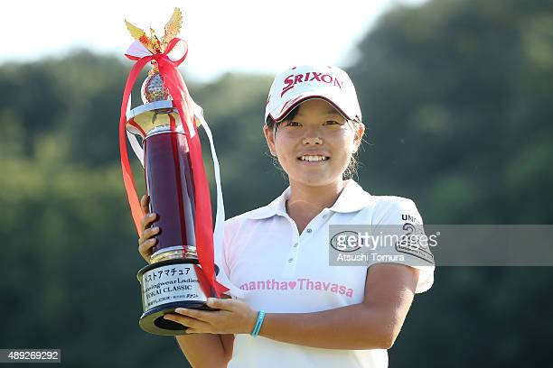 Minami Katsu of Japan poses with the trophy during the final round of the Munsingwear Ladies Tokai Classic at the Shin Minami Aichi Country Club...