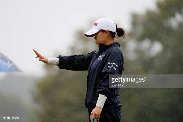 Minami Katsu of Japan reads the green on the 17th hole during the final round of the Udonken Ladies at the Mannou Hills Country Club on October 15...
