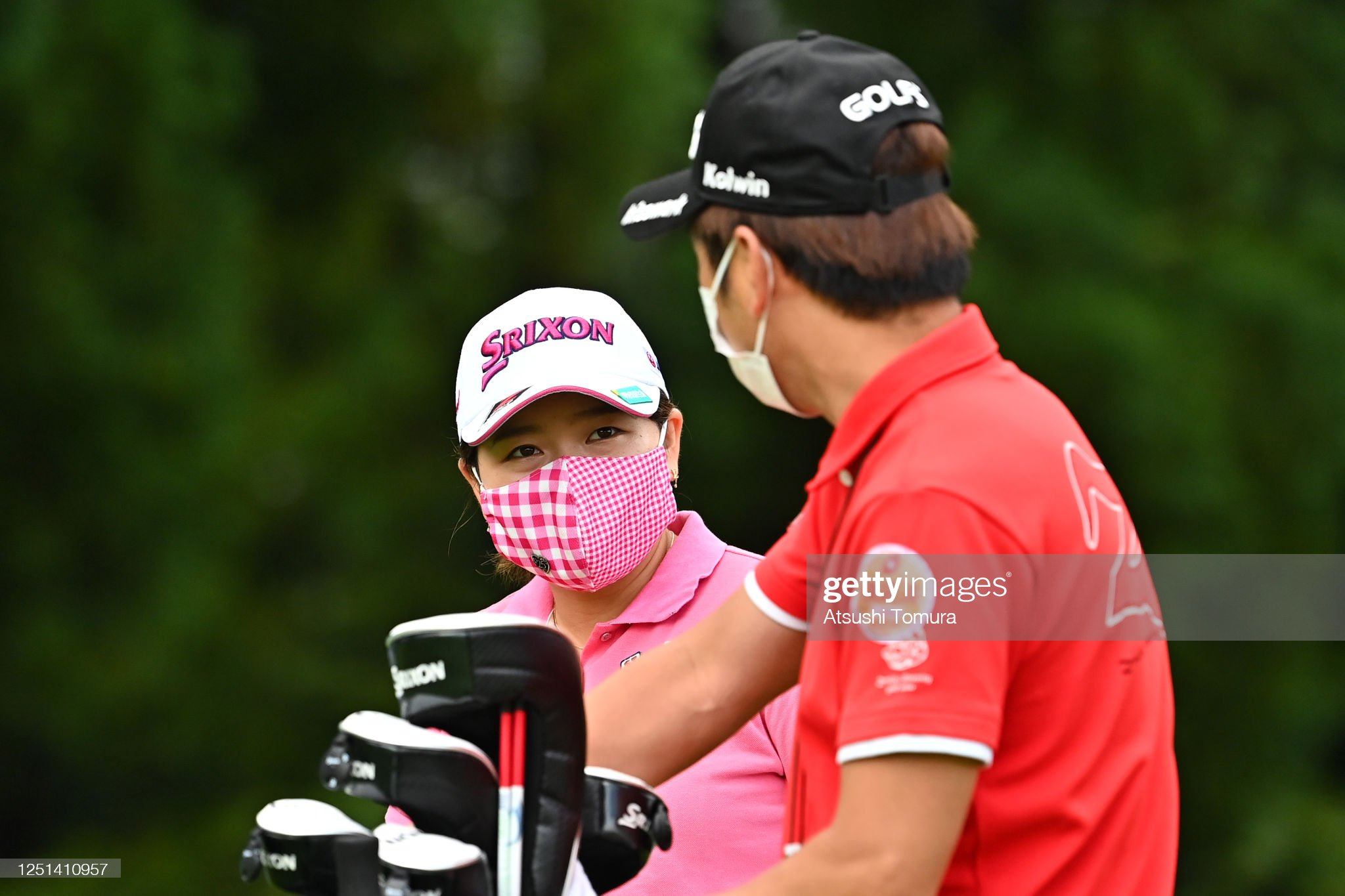 https://media.gettyimages.com/photos/minami-katsu-of-japan-talks-with-her-caddie-on-the-1st-hole-during-picture-id1251410957?s=2048x2048