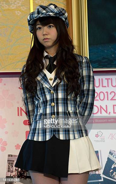Minami Minegishi of Japanese pop group AKB48 gives a press conference at the Japanese ambassador's residence in Washington on March 26, 2012. The...