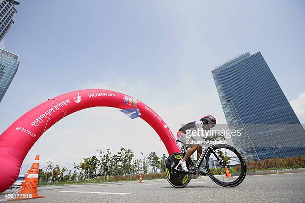 Minami Uwano of Japan rides in the women's individual time trial on day eight of the 2014 Asian Games at Songdo Road Cycling Course on September 27,...