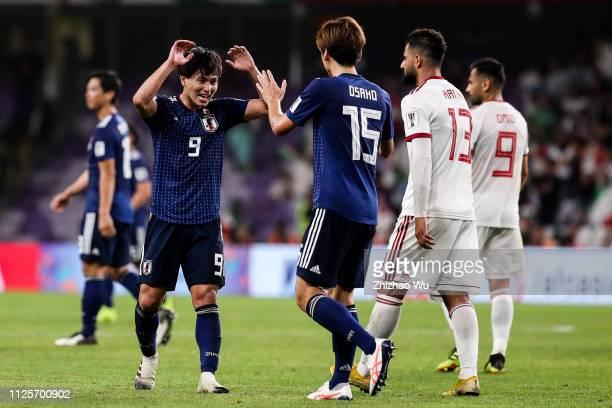Minamino Takumi of Japan celebrate the victory with Osako Yuya after the AFC Asian Cup semi final match between Iran and Japan at Hazza Bin Zayed...