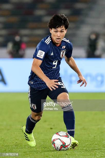 Minamino Takumi of Japan in action during the AFC Asian Cup final match between Japan and Qatar at Zayed Sports City Stadium on February 01 2019 in...