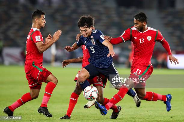 Minamino Takumi of Japan in action during the AFC Asian Cup Group F match between Oman and Japan at Zayed Sports City Stadium on January 13 2019 in...