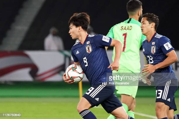 Minamino Takumi of Japan reacts after scoring a goal to make it 12 during the AFC Asian Cup final match between Japan and Qatar at Zayed Sports City...