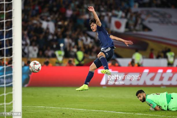 Minamino Takumi of Japan scores the first goal of his team during the AFC Asian Cup final match between Japan and Qatar at Zayed Sports City Stadium...