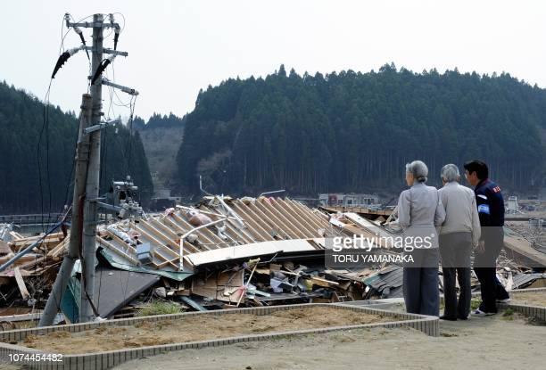 Minamisanriku Mayor Jin Saito Japanese Emperor Akihito and Empress Michiko look at tsunami devastation from the Isatomae Elementary School in...
