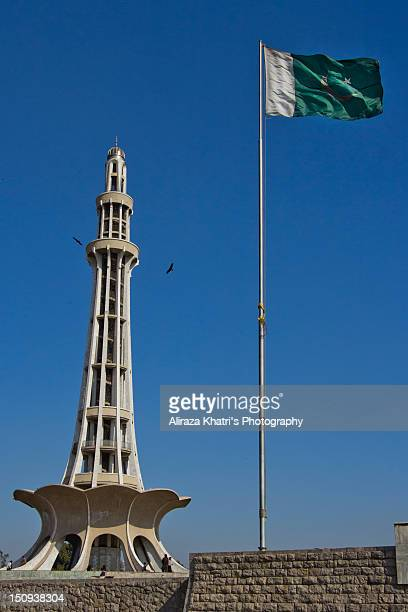 minar e pakistan - pakistani flag stock photos and pictures