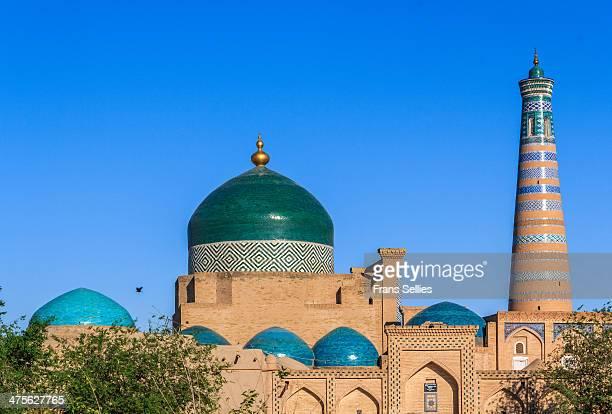 Minaret and madrassah of Islam-Khodja in Khiva, Uzbekistan. In 1908-1910 Islam-Khodja built this ensemble in the southeastern part of Itchan Kala. It...