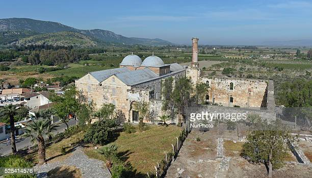 Minaret and mosque situated near the ruins of the Basilica of St. John in Ephesus constructed by Justinian I in the 6th century. It stands over the...