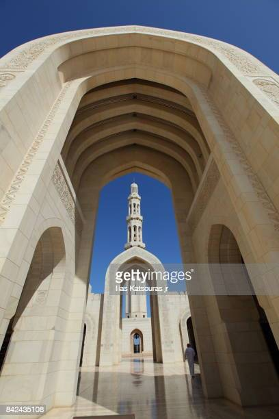 Minaret framed by arch at the Sultan Qaboos Grand Mosque, in Muscat, Oman