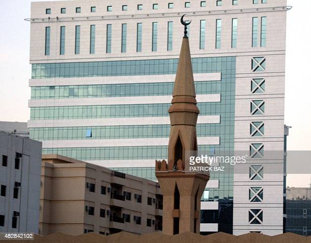 A minaret from a Muslim mosque appears in front of the modern King Faisal Foundation building in Riyadh 14 July 2004 AFP PHOTO/PATRICK BAZ