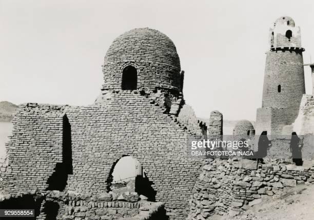 Minaret of alMashhad alBahari and the ruins of the mosque near Aswan Egypt photograph by Ugo Monneret de Villard 19291934