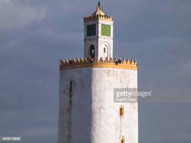 minaret of grand mosque in portuguese city of mazagan. el jadida, morocco - minaret stock pictures, royalty-free photos & images