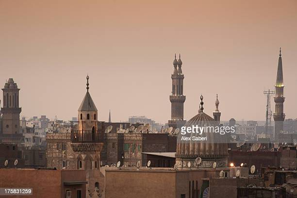 minarets and mosques of cairo at dusk. - alex saberi stock-fotos und bilder