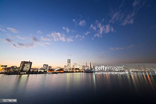 Minato Mirai skyline at twilight, with reflections on the water. Yokohama, Kanagawa Prefecture, Japan