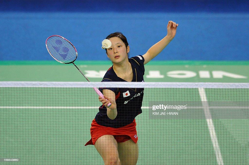 Minatsu Mitani of Japan plays a shot during her women's singles badminton match against Wang Shixian of China during the semi-finals of the Korea Open at Seoul on January 12, 2013. Wang Shixian won the match 21-11, 21-17.