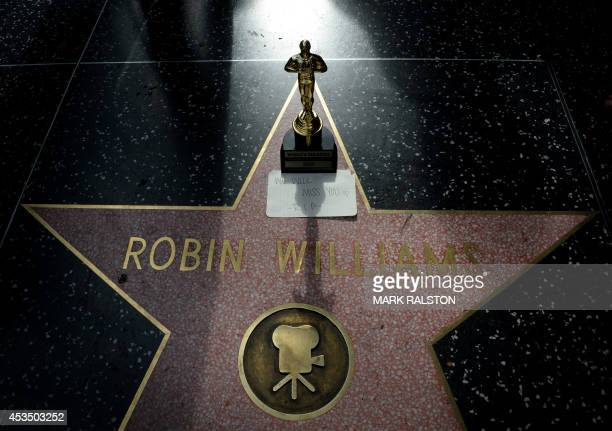 A minature Oscars statue and an I will miss you note is seen at Robin Williams' star on the Hollywood Walk of Fame is seen August 11 in Hollywood...